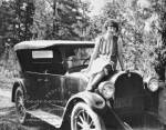 Photograph of Grace Golden, a Harvey Girl, sitting on hood of car at the Grand Canyon (Ariz.), 1926. RG 99, SG 12, 01-4770.jpg